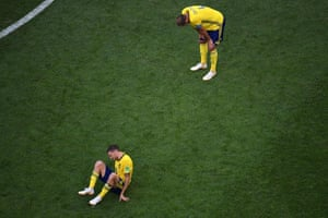 Sweden's Marcus Berg  and Andreas Granqvist react after their loss