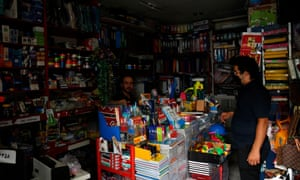 A man shopping during a power cut to save energy in Tehran earlier this month.