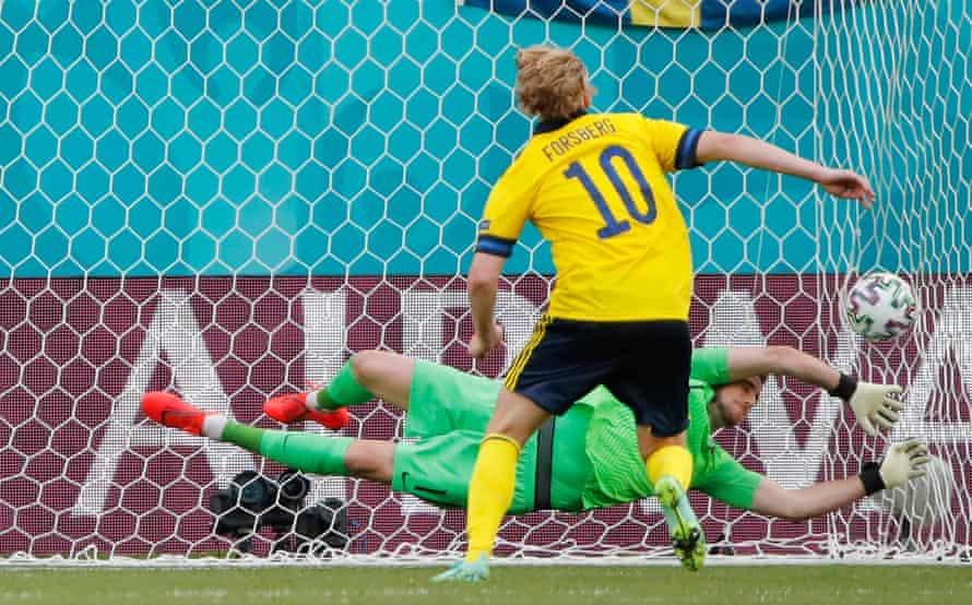 Emil Forsberg scores from the spot against Slovakia.