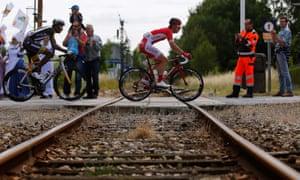 Cofidis team rider Kenneth Van Bilsen crosses a railway track during the sixth stage.