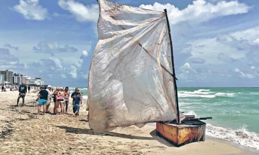 The diminutive boat was hammered out from old steel drums with a tree branch mast and plastic sails.
