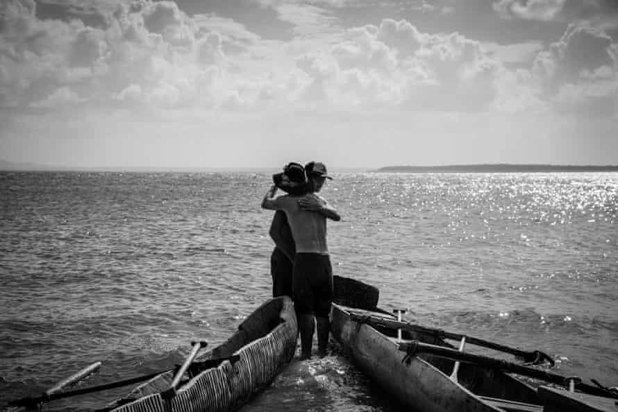 Benjamin and Bijang embrace after having made landfall