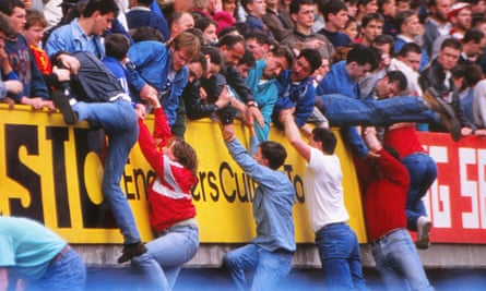 Fans are pulled to safety above the Leppings Lane terrace.