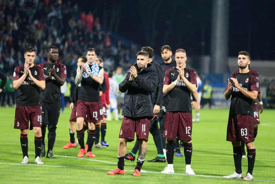 Milan players applaud their fans after a win at Spal, but they must settle for a Europa League spot.