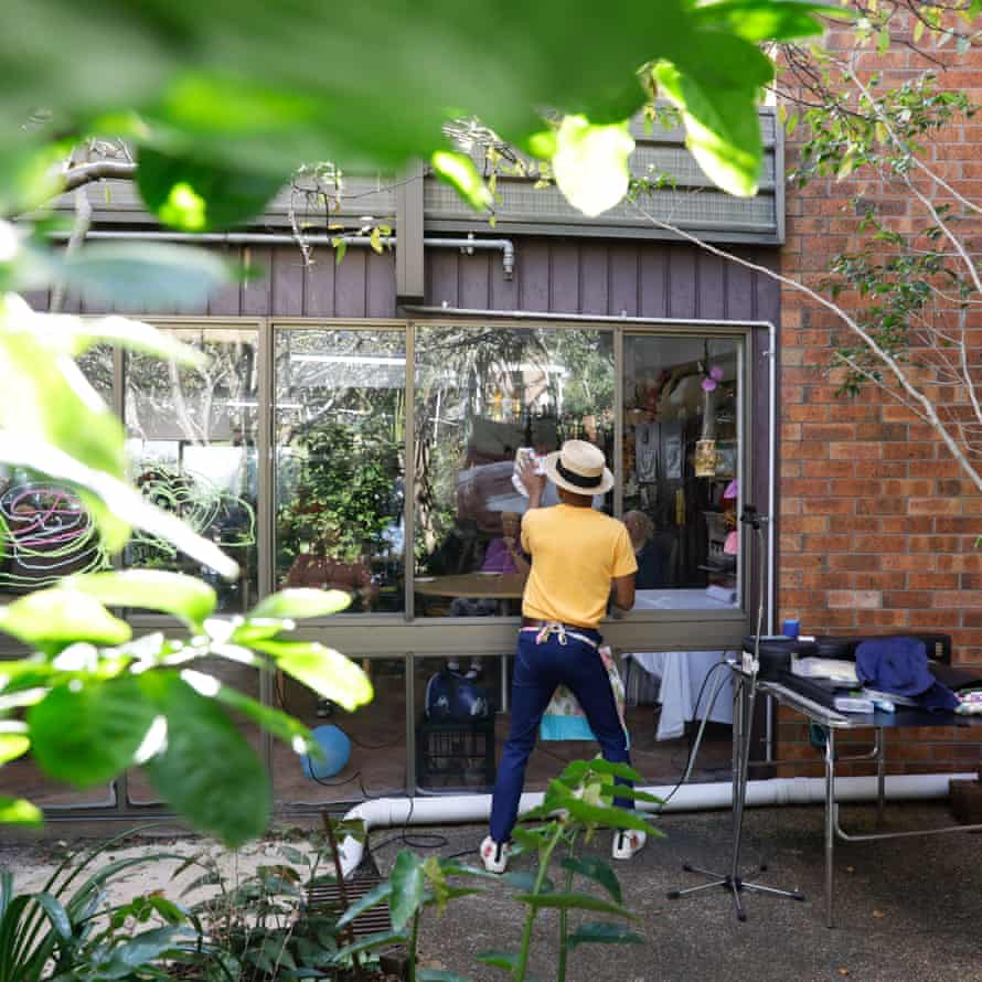 Benhur Helwend creating window art at the Whiddon aged care home in Sydney's north shore.
