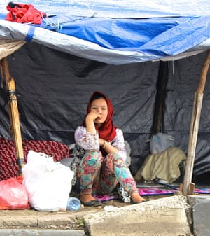 Hazara asylum seeker Sharmila Attaie, 10, in a makeshift shelter outside the Kalideres immigration detention centre