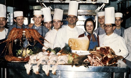 Paul Bocuse, centre, in his restaurant kitchen in 1973; two years later he was made a chevalier of the Légion d'honneur.