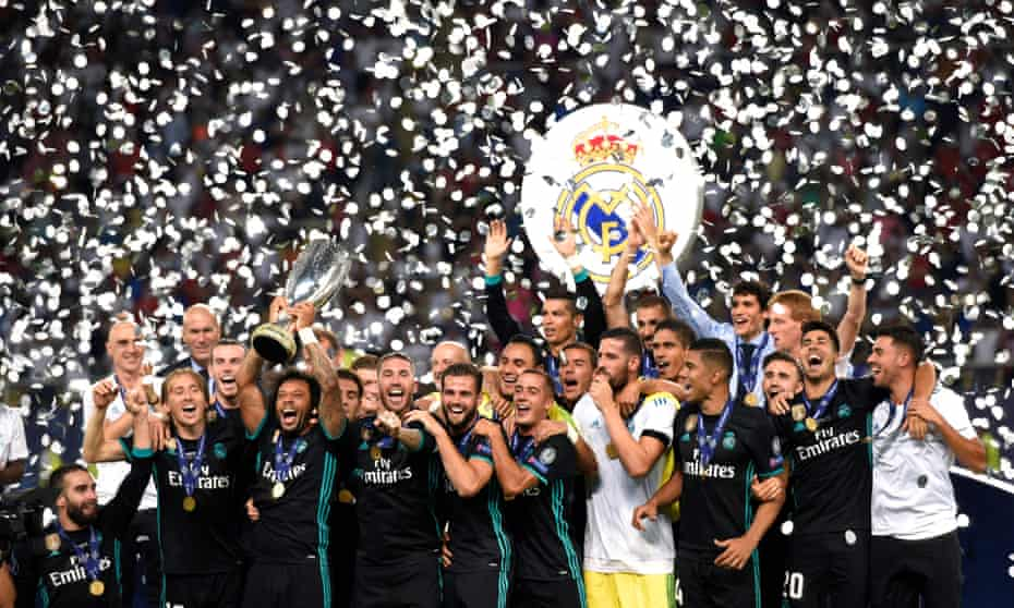 Real Madrid's players celebrate with the UEFA Super Cup trophy after beating Manchester United 2-1 in Skopje