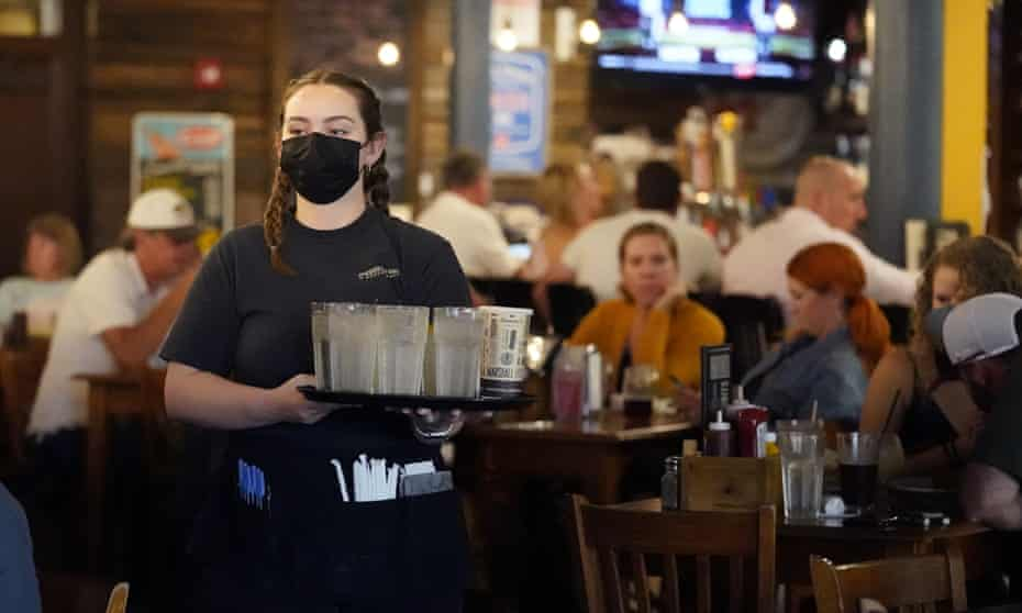 Mariah Tabb carries drinks to a table at a restaurant in Nashville on 10 September.