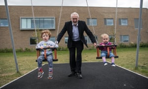 Jeremy Corbyn pushes Isabella (right) and Freddie, the children of local parliamentary candidate, Anneliese Dodds, during a visit to a play park with Mrs Dodds and her family in Oxford, England.