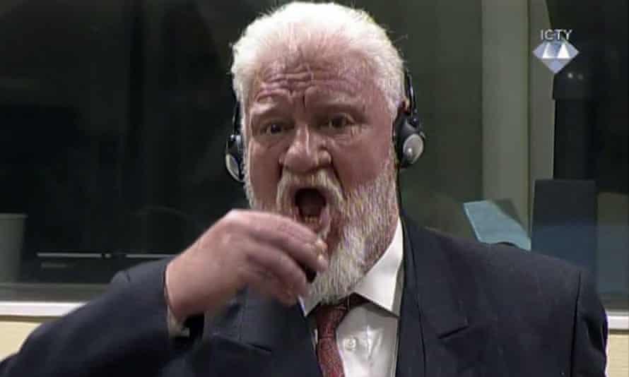 Slobodan Praljak drinks the cyanide poison.