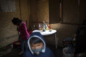 Mirella Pariona sweeps inside the Virgen Poderosa soup kitchen in the Nueva Esperanza neighbourhood of Lima, Peru