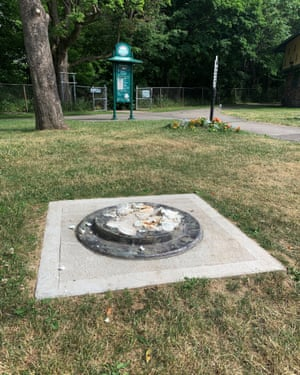 This photo provided by WROC-TV shows the remnants of a Frederick Douglass statue ripped from its base at a park in Rochester, New York