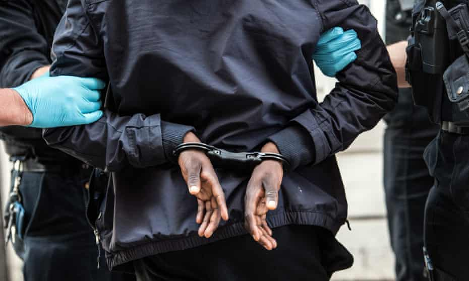 Handcuffed suspect on London street, UK