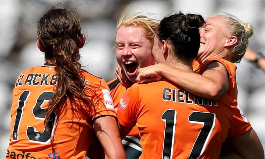 Brisbane Roar teammates celebrate a goal