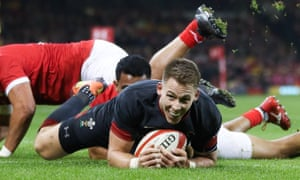 Liam Williams powers over for a Welsh try.