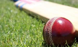 Red cricket ball and paddle