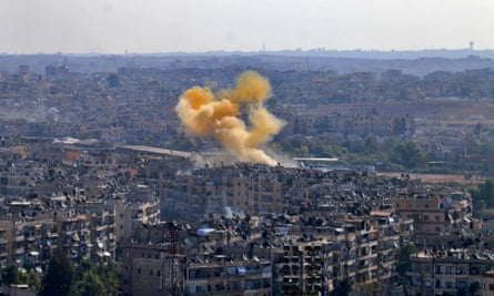 Smoke rises from reported opposition fire from buildings in an eastern government-held neighbourhood of Aleppo