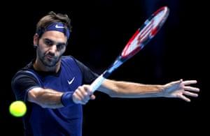 Federer returns with a backhand.