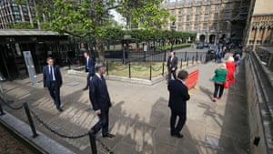 MPs including leader of the House of Commons, Jacob Rees-Mogg, queue outside the Houses of Commons on 2 June.