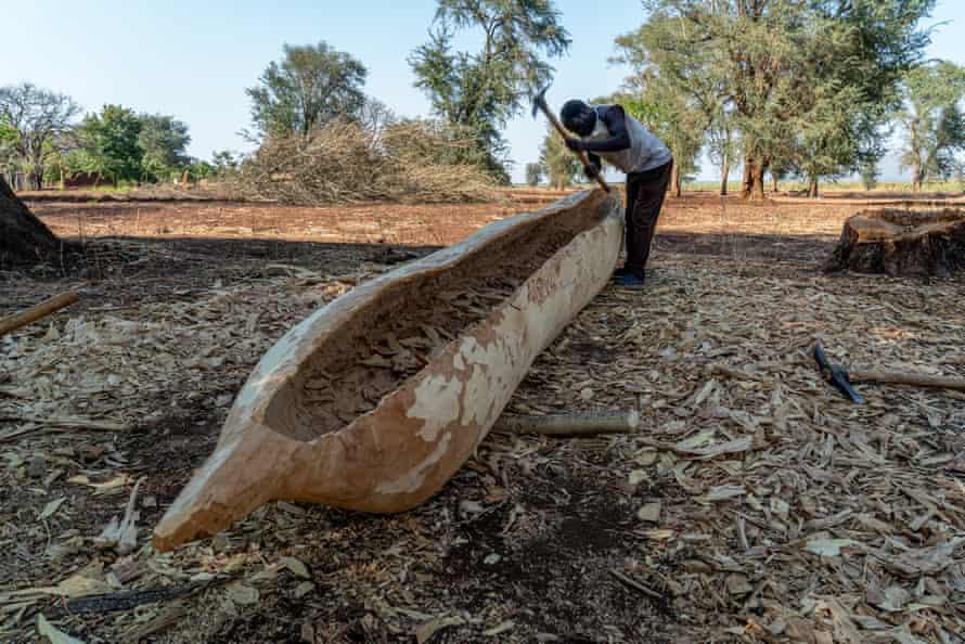 White Lagwani, 60, a fisherman and canoe maker, at work on Chisi Island, Malawi
