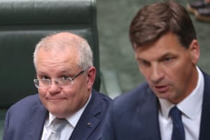 The prime minister Scott Morrison watches Emissions reduction minister Angus Taylor during question time on Wednesday 4th December 2019.