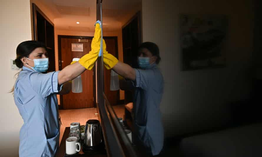 A member of staff cleans a room for a guest at a hotel near Heathrow airport.