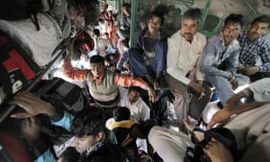 Passengers on a train in New Delhi, India. Indian Railway is amongst the world's largest.