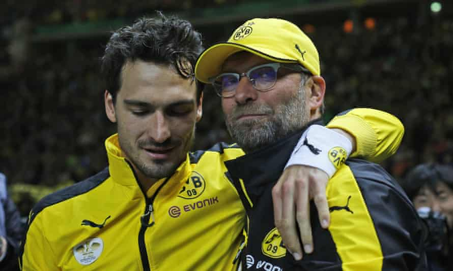 Mats Hummels, left, puts his arm around Jürgen Klopp at the end of his final match in charge of Borussia Dortmund - the 2015 German Cup Final, which Dortumund lost to Wolfsburg