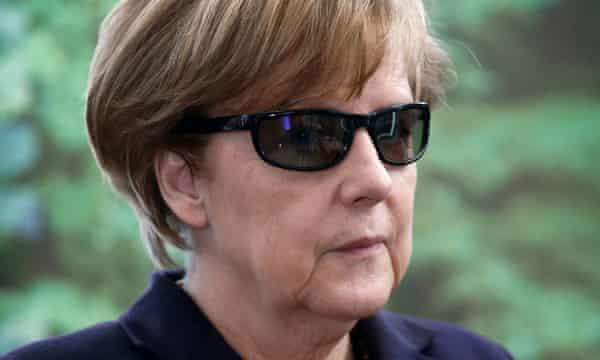 German chancellor Angela Merkel in dark glasses.