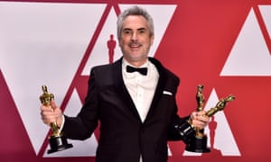 Alfonso Cuarón with his best director, best foreign film and best cinematography Oscars for Roma. Best picture eluded him – and Netflix.