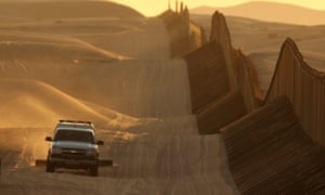 A border patrol vehicle on a recently constructed section of the US-Mexico border fence in California.