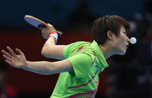 Ning Ding of China takes on compatriot Xiaoxia Li in the Olympic women's singles table tennis final at the ExCel centre.