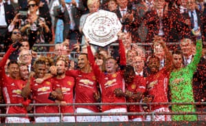 Wayne Rooney lifts the 2016 Community Shield Trophy.