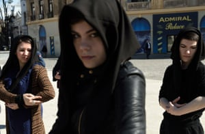 Bucharest, Romania Women wearing black scarfs adopt a mother care posture during a flash mob