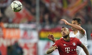 Bayern Munich's Arturo Vidal, front, and Benfica's Jonas vie for the ball.