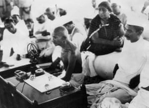 Mohandas Karamchand Gandhi (centre), also known as Mahatma (Great soul) speaking during a meeting of the All-India Congress in Bombay (now Mumbai) in 1942.