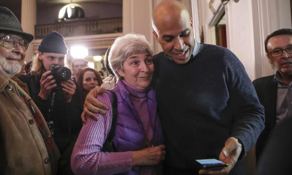 Cory Booker prepares to take a selfie with a supporter in Manchester.