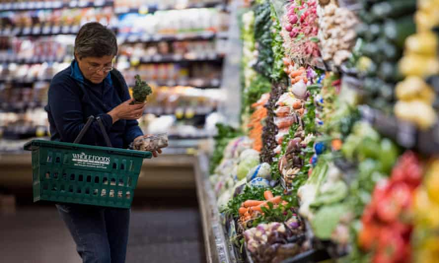 A customer shops for produce at a Whole Foods Market in Oakland, California.