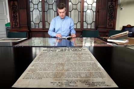 Shane Mawe, assistant librarian at Trinity College, with the historic proclamation document.