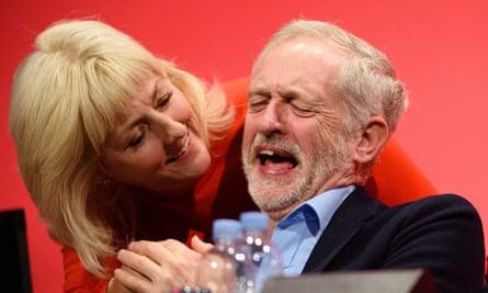 Jeremy Corbyn shares a joke with Jennie Formby.