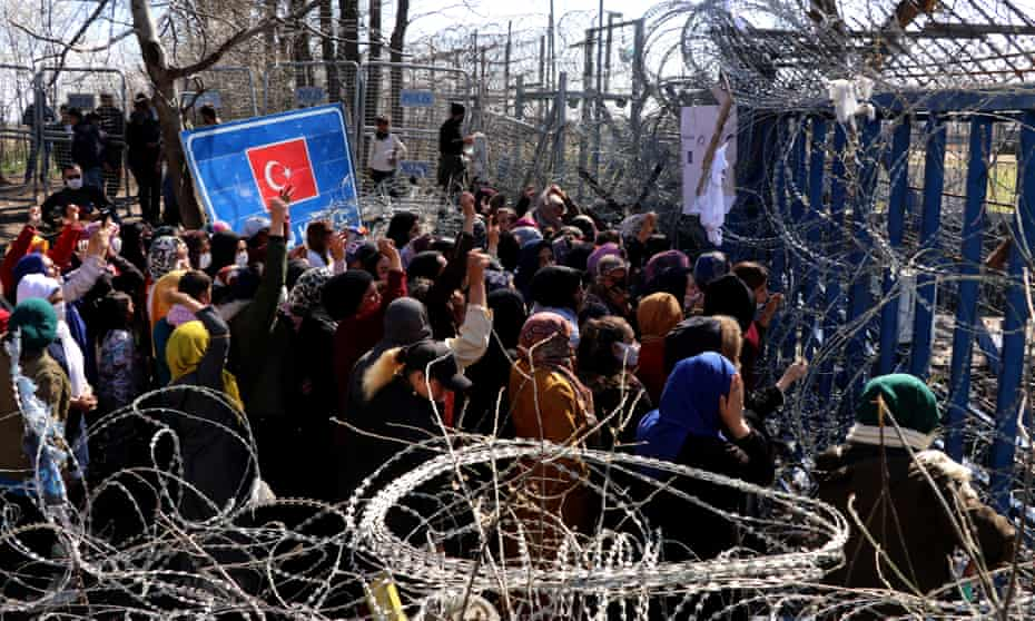 Asylum seekers in Turkey marching towards Kastanies border crossing in March during a rally calling for Greece to open the border gate.