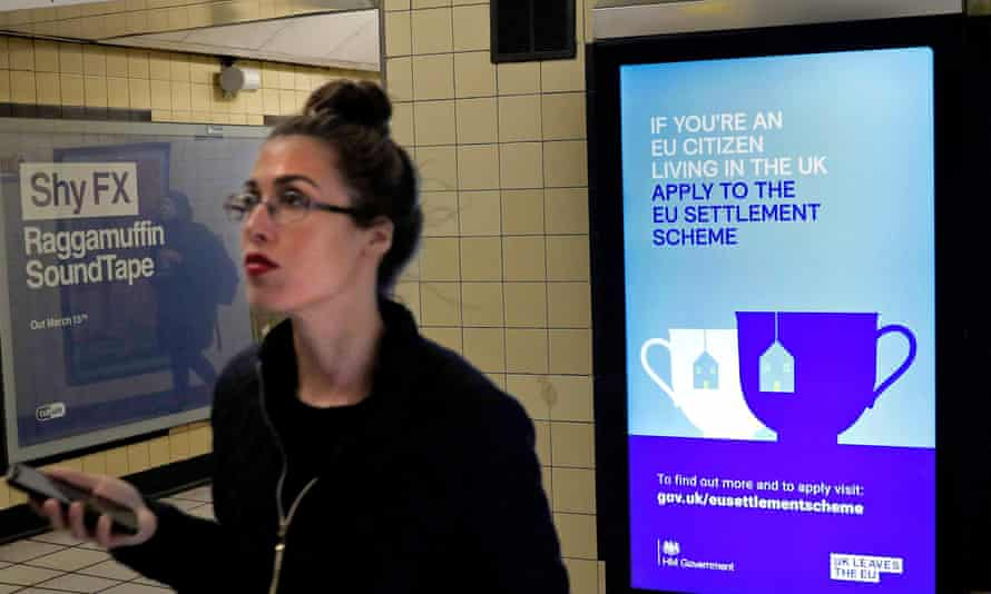 A government advertisement at South Kensington station in London encouraging EU nationals to apply to the EU settlement scheme.