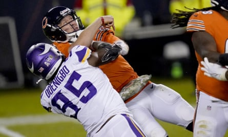 Nick Foles tries to throw under pressure from Minnesota Vikings defensive end Ifeadi Odenigbo