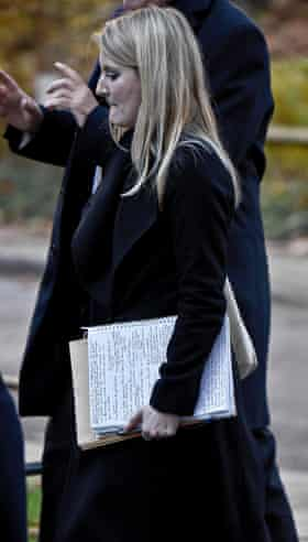 The woman, believed to be Julia Dockerill, walks along Downing Street with the document.