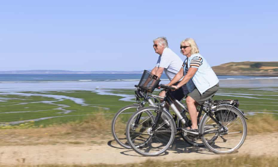 A couple riding electric bicycles