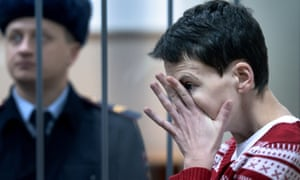 Nadiya Savchenko inside a defendants' cage as she attends a hearing at the Basmanny district court in Moscow in March.