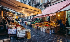 Elixir of life? Vegetables and fruits for sale on old fish market La Pescheria in Catania city, Italy