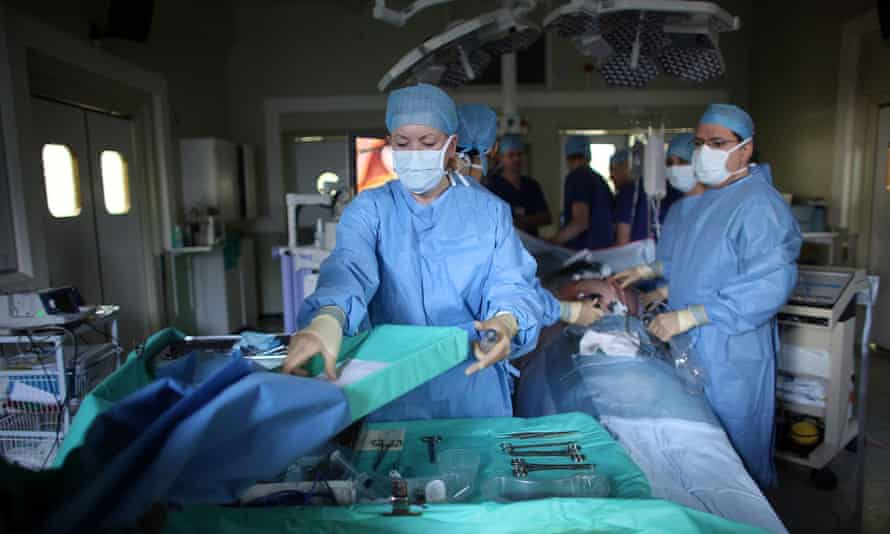 Surgeon and team performing keyhole surgery