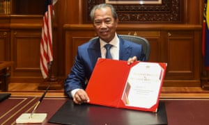 Malaysia's new prime minister, Muhyiddin Yassin, posing for pictures